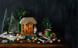 Beautiful background with gingerbread house. Modern food still life, Christmas holiday card, rustic background Stock Photography