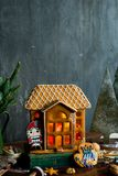 Beautiful background with gingerbread house. Modern food still life, Christmas holiday card, rustic background Royalty Free Stock Photo