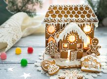 Beautiful background with gingerbread house. Modern food still life, Christmas holiday card, rustic background Stock Photo