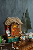 Beautiful background with gingerbread house. Modern food still life, Christmas holiday card, rustic background Stock Images