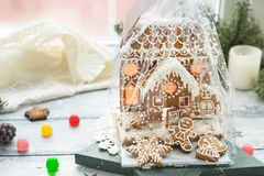 Beautiful background with gingerbread house. Modern food still life, Christmas holiday card, rustic background Royalty Free Stock Photography