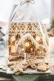 Beautiful background with gingerbread house. Modern food still life, Christmas holiday card, rustic background Royalty Free Stock Photos