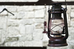 Kerosene lamp on the background of a stone wall Royalty Free Stock Images