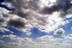Beautiful background with light clouds against the blue sky stock photos