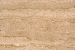 Beautiful background of natural stone marble beige, called Travertino Alabastrino stock photography