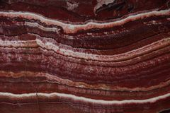 Beautiful background of natural stone onyx red with white veins, called Onice Fantastico stock photography