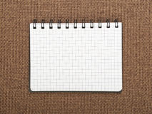 Beautiful background. Notebook on brown canvas background Royalty Free Stock Image