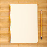 Beautiful background. Notebook on natural bamboo textured background Royalty Free Stock Photos