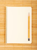 Beautiful background. Notebook on natural bamboo textured background Royalty Free Stock Image