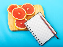 Beautiful background. Notebook with products isolated on a blue background Stock Photo