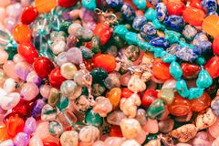 Beautiful background with plenty of colorful stone beads. Collection of colorful beads. Gemstone beads stock image