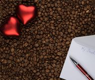 Two hearts on coffee with love letter royalty free stock photo