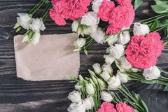 Beautiful background of red and pink roses and white eustoma flowers on wooden background. For Mother`s Day and. Valentine`s day . Copy space. A horizontal Royalty Free Stock Images