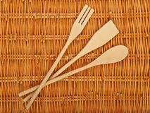 Beautiful background. A set of wooden spoons on  natural basket textures background Stock Photography