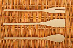 Beautiful background. A set of wooden spoons on  natural basket textures background Stock Photo