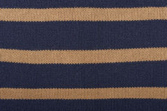 Beautiful background. Texture of knitted wool cotton striped fabric Stock Image