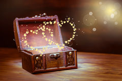 Beautiful background of vintage chest with light heart miracle o Stock Images