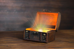 Beautiful background of vintage chest with light miracle on wood Stock Photography
