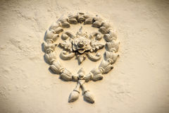 Beautiful background with white garland flowers stucco on the ol Royalty Free Stock Images
