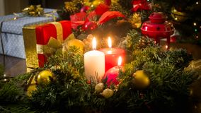 Beautiful background for winter holidays and celebrations. Burning candles in Christmas wreath Royalty Free Stock Photography