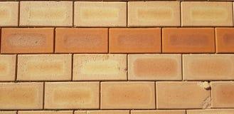 Red brick background. brickwork texture. Large cracks, dry boards. stock photos