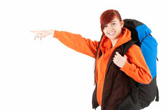 Beautiful backpacker girl pointing ahead Royalty Free Stock Photo