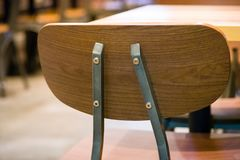 Beautiful backrest brown chair for meeting at coffee shop and fast food blurry bokeh background.wooden chair for sitting and. Eating meal at beautiful royalty free stock photos