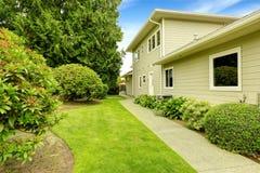 Beautiful backyard garden with walkway. Real estate in Federal W Stock Photo