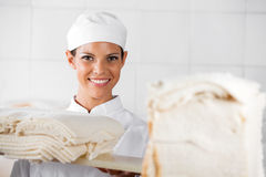 Beautiful Baker With Bread Slices In Bakery Royalty Free Stock Image