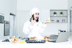Beautiful baker with cupcake Stock Image