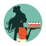 Beautiful baker holding freshly baked cake Royalty Free Stock Photography