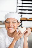 Beautiful Baker Holding Heart Shape Dough In Bakery Stock Photography