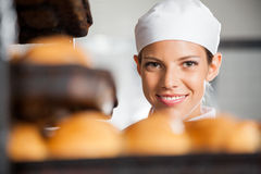 Beautiful Baker Smiling In Bakery Stock Image