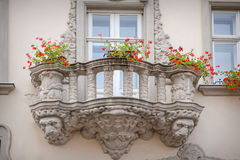 Beautiful balcony in a classic style with flowers Stock Photos