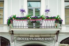 Beautiful balcony decorated with flowers. Typical architecture of Petersburg stock image