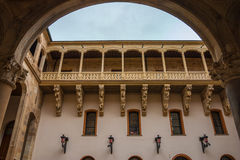 Beautiful balcony in Salina Palace courtyard. Full view of stone carved balcony in the courtyard of Salina Palace located in Salamanca Stock Photo