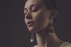 Beautiful bald-headed girl over dark grey Stock Photos