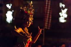 Beautiful balinese woman dances during a traditional Kecak Fire Dance ceremony in Hindu temple. Stock Photography