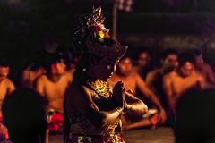 Beautiful balinese woman dances during a traditional Kecak Fire Dance ceremony in Hindu temple. Royalty Free Stock Images