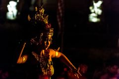 Beautiful balinese woman dances during a traditional Kecak Fire Dance ceremony in Hindu temple. Royalty Free Stock Photography