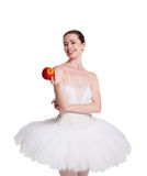 Beautiful ballerina with apple isolated on white background Royalty Free Stock Photos