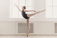 Beautiful ballerina in arabesque ballet position Stock Photography