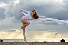 Beautiful ballerina is dancing at the beach Royalty Free Stock Photography