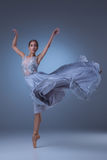 The beautiful ballerina dancing in blue long dress Stock Photo