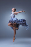 The beautiful ballerina dancing in blue long dress Royalty Free Stock Images