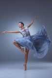The beautiful ballerina dancing in blue long dress Stock Image
