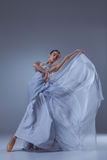 The beautiful ballerina dancing in blue long dress Royalty Free Stock Photos