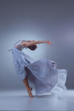 The beautiful ballerina dancing in blue long dress Royalty Free Stock Image