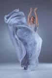 The beautiful ballerina dancing in blue long dress Stock Image