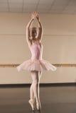 Beautiful ballerina dancing en pointe Royalty Free Stock Images